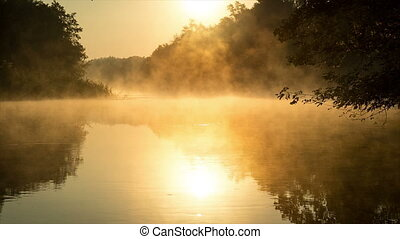 Morning fog on a calm river, sepia toned - Morning fog on a...
