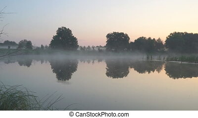 Morning fog on a quiet lake