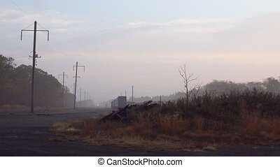 morning fog on railway station in the countryside