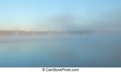 Morning fog on the lake in the frosty morning