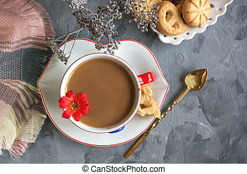 Morning hot chocolate in the original white Cup with a blue button on the background of biscuits. Invigorating Breakfast