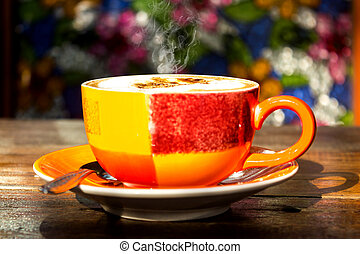 morning hot coffee on colorful cup