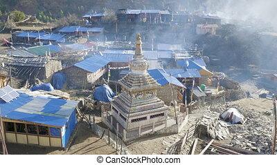 Morning in Nepalese village Lho. Manaslu circuit trek. - ...
