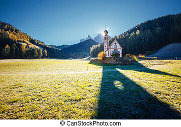 Morning in St. Magdalena village. Location place San Giovanni Church, Funes Valley, Dolomites.