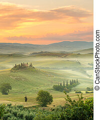 Morning in Tuscany - Dawn in a misty valley with view on ...