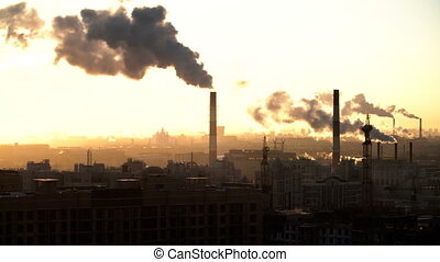 Morning in urban city. St. Petersburg. From pipe goes smoke....