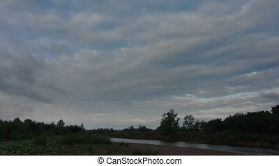 morning landscape with rain clouds over river timelapse