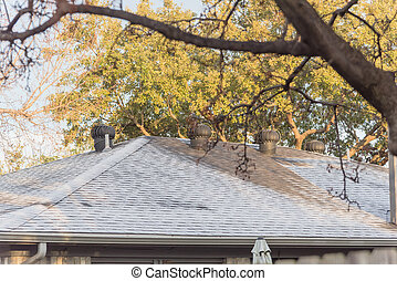 Morning light and frost on black shingle roof of residential house near Dallas, Texas, America