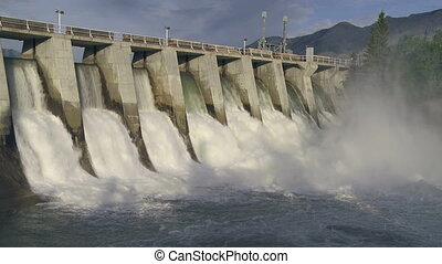 Morning Light on Hydro Dam - Wide shot of a hydroelectric...