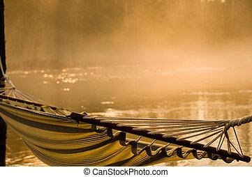 Morning Mist - moring mist in warm orange glow on the river