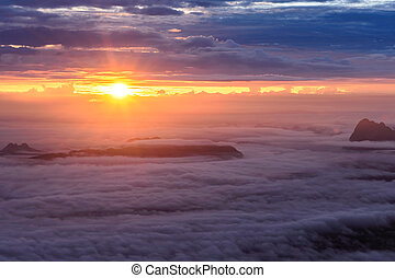 Morning mist with mountain at sunrise in Phu Kradueng national park ,Loei Thailand.