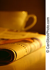 morning impression with newspaper and unsharp cup;