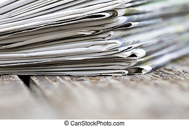Morning news concept - newspapers stack close-up with copy space