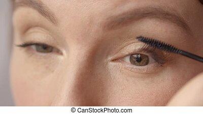 Morning nice make-up - beautyful woman applying mascara on...