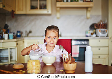 Morning of one girl - Girl pouring milk and looking at...