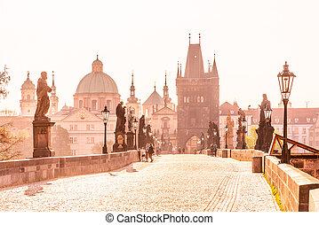 Morning on CHarles Bridge, Czech: Karluv most. Hazy sunrise daybreak. Praha, Czech Republic.