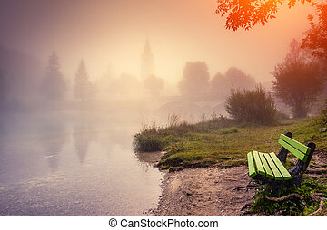 morning on the lake - Majestic colorful foggy morning on the...