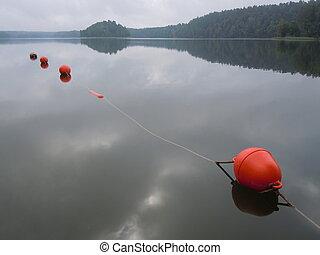 Morning on water surface bouy - Floating bouy on lake ...