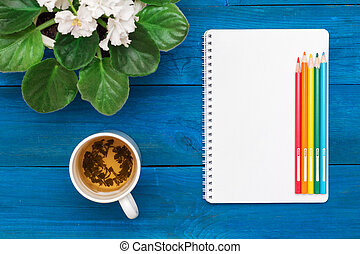 morning over a cup of green tea with notepad
