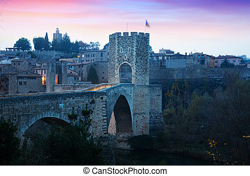medieval stone bridge with gate, built in 12th century. ...