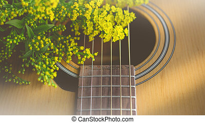 Morning relaxation and cozy with small yellow flower on guitar in vintage tone  for Rural vacation lifestyle , music therapy concept