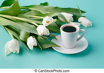 Morning romantic gift with white tulips and coffee cup