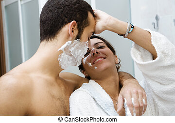 shaving - morning routine: the guy shaving and the girl...