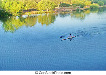 Morning Row Austin, Texas - Women rows on a peaceful and...