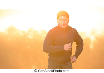 Morning running - Young man running outdoors in the morning.