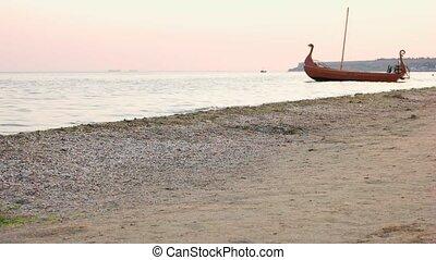 Morning seashore and boat. Anchored boat near seashore...