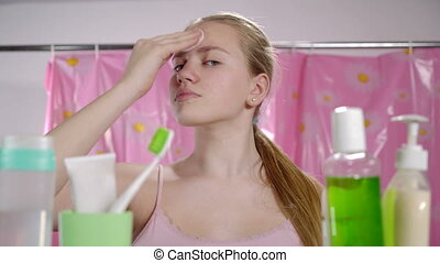 Morning skincare routine in bathroom for teens