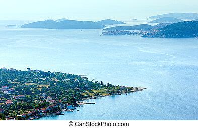 Morning summer coastline and village on seashore (Peljesac pe