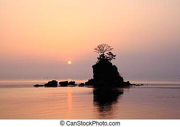 Morning sun at the Amaharashi coast
