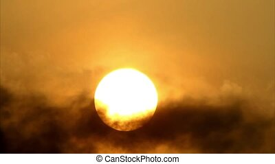 Morning Tropical sun seen behind the moving cloud as it ascend in the eastern sky in full HD 1920x1080
