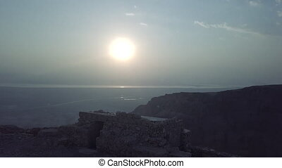 Morning sun in israel desert, remains of masada fortress,...