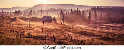 Morning sun rays in the fog mountains house