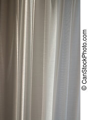 Morning sun shines through the curtains.