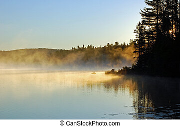 morning - Sunrise and mist in beautiful lake in Algonquin...