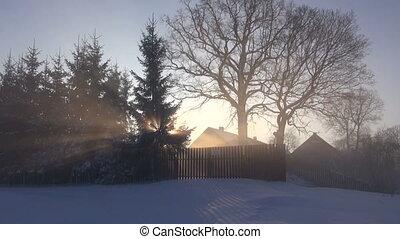 morning sunrise and winter fog in village