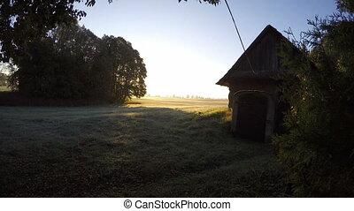Morning sunrise in village. Time lapse 4K