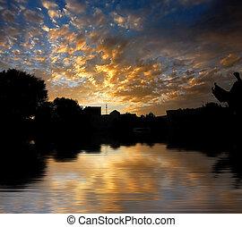 Morning sunrise on water surface