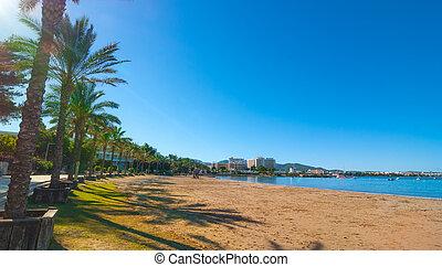 Morning sunshine on the bay & beach in St Antoni de Portmany, Ibiza, Balearic Islands, Spain.