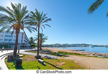 Morning sunshine on the bay in St Antoni de Portmany, Ibiza, Balearic Islands, Spain.