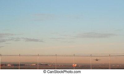Morning takeoff. - Commercial passenger jet taking off....