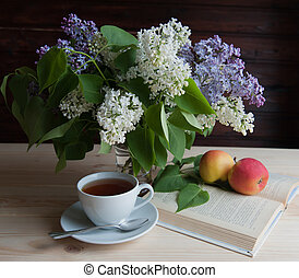 morning tea - tea with a book on the table and brimstone