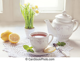 Morning tea with lemon - Hot tea with lemon on bright...
