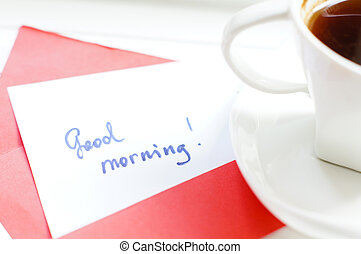 Morning time: cup of coffee and Good morning greeting card