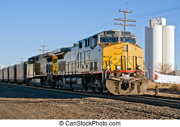 Morning Train - Freight train traveling through a rural town...
