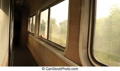 Morning Train Ride - Sun peaks through train windows in the...