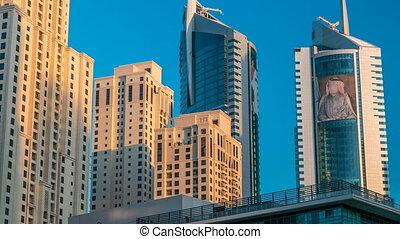 Morning view of Dubai Marina Towers in Dubai timelapse